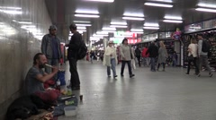 Young man homeless in city begging and young girl gives tin beer Stock Footage