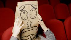 Breadbag face movie theater scared Stock Footage