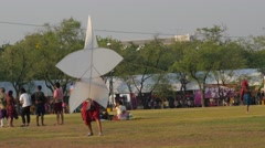 Lauching of kite by man in traditional clothes,Bangkok,Thailand Stock Footage
