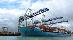 Big cargo ship unloading containers in Ports of Auckland New Zealand Stock Footage