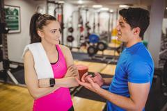 Stock Photo of Trainer and client discussing her progress
