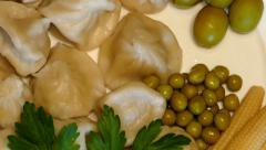 4k – Boiled meat dumplings with vegetables and ketchup on plate 02 Stock Footage