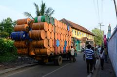 Indian drivers preparing heavily overloaded truck for travelling at Kerala,India Stock Photos