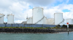 Bulk Storage Terminals against Auckland skyline New Zealand - stock footage