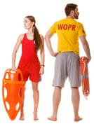 Stock Photo of Lifeguards with rescue and ring buoy lifebuoy.