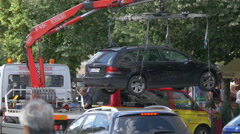 One unauthorized parked car towed away in Wenceslas Square, Prague Stock Footage