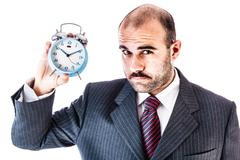 Businessman with alarm clock - stock photo