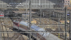 Long train arriving into the Prague Main Railway Station in Prague Stock Footage