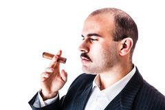Meditating businessman - stock photo