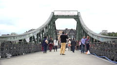 People visiting Eisener Steg bridge in Frankfurt Germany 4k Stock Footage