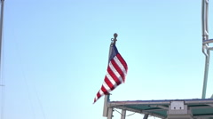 American Flag on boat blowing in wind on sunny summer day 4k Stock Footage