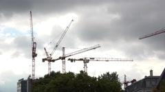 Tower Cranes on cloudy sky in Frankfurt Germany 4k Stock Footage