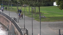 People along Main river in Frankfurt on bike path 4k Stock Footage