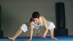 4K Serious female martial artist stretching out at the gym Stock Footage