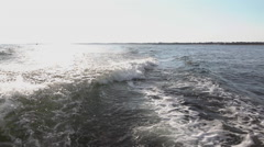 Waves coming off back side of boat slow motion Stock Footage