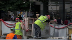 Three workers with vests working on the street in Prague Stock Footage
