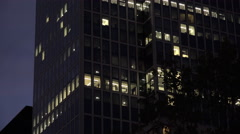 Exterior of office with lit windows at night 4k - stock footage