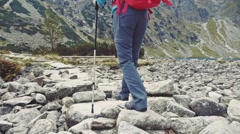Woman hiking on a mountain trek, Close up on feet. Stabilized Slow-Mo 120 fps. Stock Footage