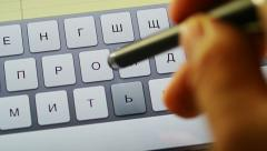 Typing Russian on tablet computer Stock Footage