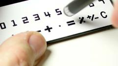 Stylus over calculator Stock Footage