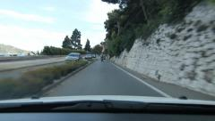 Road beside cliff face above VilleFranche, South of France. Stock Footage