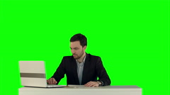 Business people discussing document on a Green Screen - stock footage