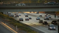 Freeway traffic in the late afternoon Stock Footage
