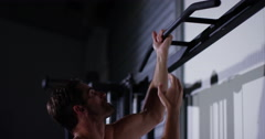 Handsome muscular male model with perfect body doing pull ups. Shot on RED Epic. - stock footage