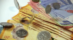 Coins falling on Malaysia Ringgit Notes, Slow Motion at 250fps Stock Footage