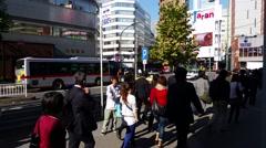 Gotanda Tokyo Neigbourhood people walk past Stock Footage