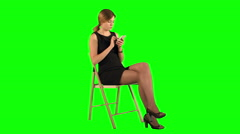 Young Business Woman Using Telephone on a Green Screen Stock Footage