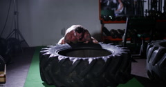 A man flips a tire during his cross fir training. Shot on RED Epic. Stock Footage