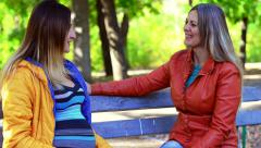 Two beautiful women in old park - stock footage