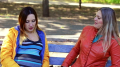 Pregnant girl shares her experiences with her sister - stock footage