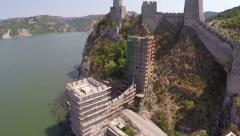 Flight over the old fortress on the riverbank. - stock footage
