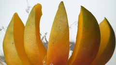 Water splash and mango. Slow Motion. Stock Footage