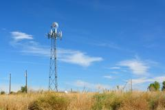 Cell Tower Disguised as a Farm Windmill - stock photo