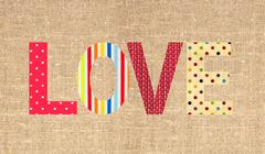 Textile letter love on sack canvas burlap background - stock illustration