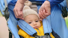 Sad Cutie in Buggy Stroller - stock footage