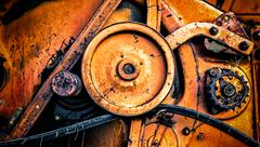 Abstract of agricultural old Soviet USSR combine harvester cogs with rust and - stock photo