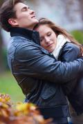 Stock Photo of romantic young couple have fun in city park at autumn season
