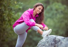 Stock Photo of Fit woman tying her shoelace