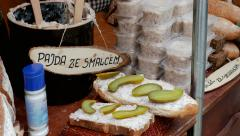 Open food market. Slice of bread with lard and cucumber Stock Footage