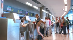 Airline passengers checking in at an airline counter in the Valencia Airport. Stock Footage