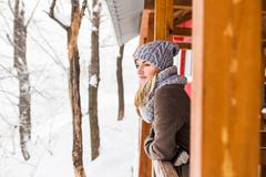 Attractive young woman in wintertime - stock photo