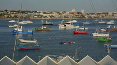 Cascais, PORTUGAL - september, 2015: Coloful fishing boats in the port of Stock Footage