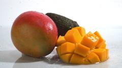 Rotating mango and avocado. Slow Motion. - stock footage