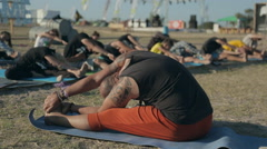 OLENEVKA,CRIMEA/RUSSIA-AUGUST 8,2015: yoga classes in the open air at the Stock Footage
