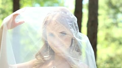 Portrait of beautiful young bride under bridal veil. Close up of pretty face Stock Footage