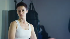 4K Serious female martial artist in training at the gym Stock Footage